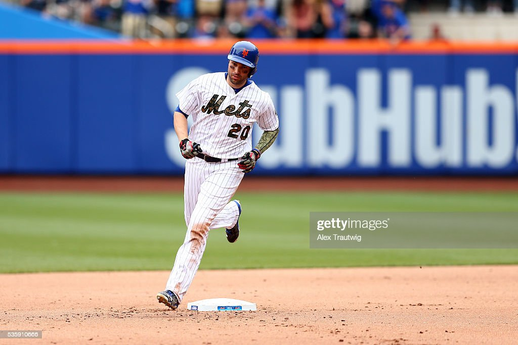 <a gi-track='captionPersonalityLinkClicked' href=/galleries/search?phrase=Neil+Walker+-+Baseball+Player&family=editorial&specificpeople=7841262 ng-click='$event.stopPropagation()'>Neil Walker</a> #20 of the New York Mets rounds the bases after hitting a solo home run in the seventh inning during the game against the Chicago White Sox at Citi Field on Monday, May 30, 2016 in the Queens borough of New York City.