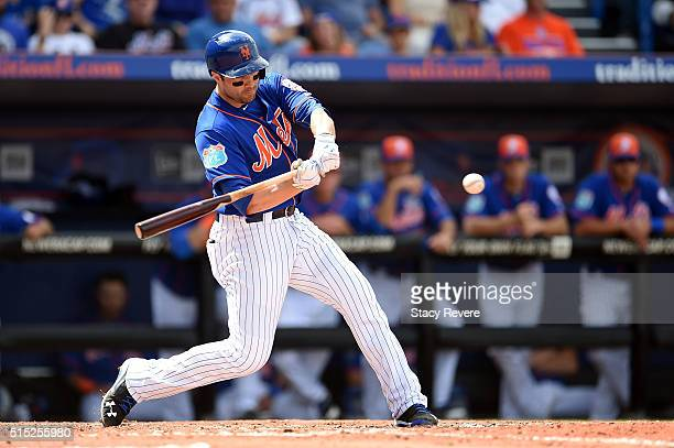 Neil Walker of the New York Mets swings at a pitch during a spring training game against the St Louis Cardinals at Tradition Field on March 12 2016...