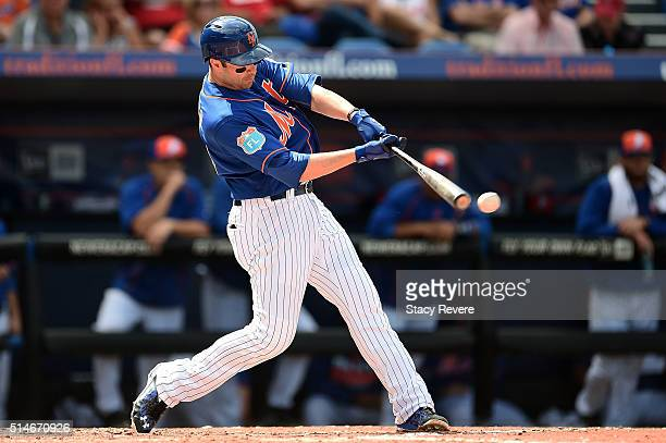 Neil Walker of the New York Mets swings at a pitch during the fourth inning of a spring training game against the St Louis Cardinals at Tradition...