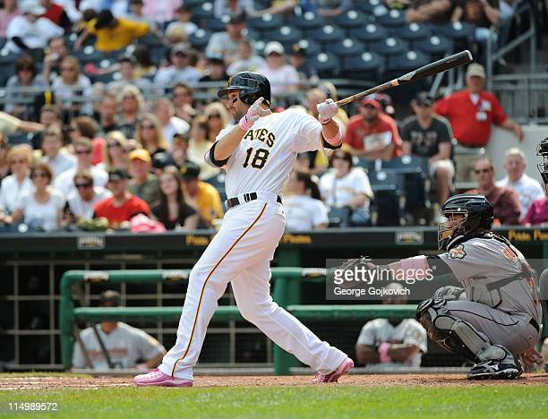 Neil Walker of the Pittsburgh Pirates bats as catcher Humberto Quintero of the Houston Astros looks on during a game at PNC Park on May 8 2011 in...