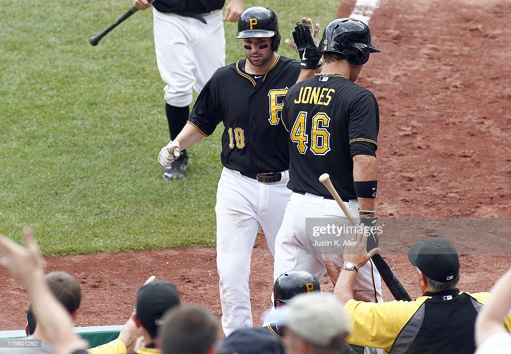 Neil Walker #18 of the Pittsburgh Pirates celebrates after hitting a sacrifice fly in the seventh inning against the Miami Marlins during the game on August 8, 2013 at PNC Park in Pittsburgh, Pennsylvania.