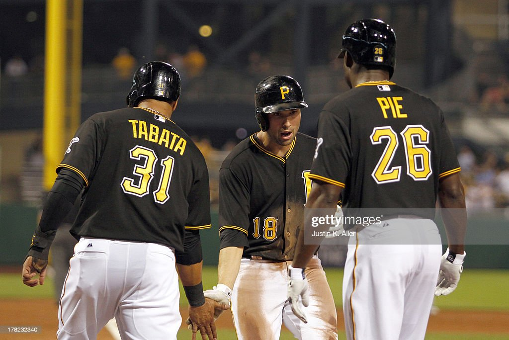 Neil Walker #18 of the Pittsburgh Pirates celebrates after hitting a three run home run in the fifth inning against the Milwaukee Brewers during the game on August 27, 2013 at PNC Park in Pittsburgh, Pennsylvania.