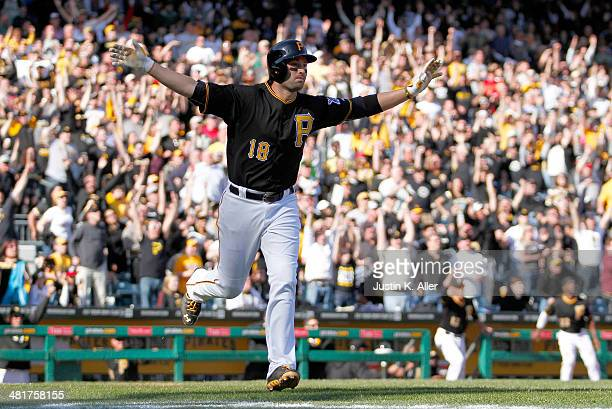 Neil Walker of the Pittsburgh Pirates celebrates after hitting a walk off solo home run in the tenth inning against the Chicago Cubs during Opening...
