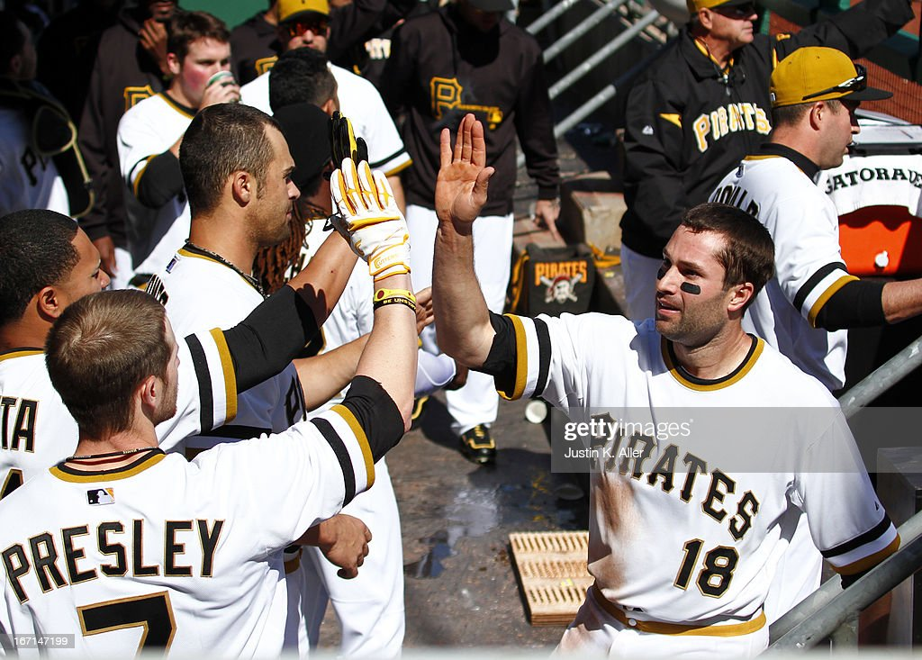 Neil Walker #18 of the Pittsburgh Pirates celebrates after scoring on a infield RBI single in the sixth inning by Clint Barmes #12 (not pictured) during the game on April 21, 2013 at PNC Park in Pittsburgh, Pennsylvania. The Pirates defeated the Braves 4-2.