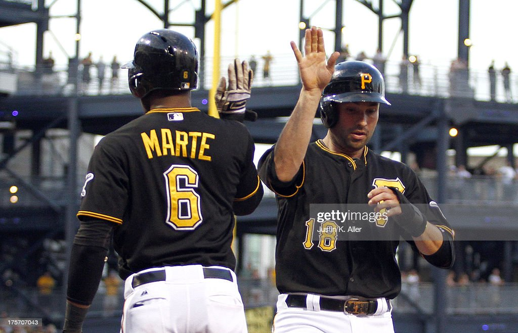 Neil Walker #18 of the Pittsburgh Pirates celebrates after scoring on a two RBI double in the third inning against the Miami Marlins during the game on August 6, 2013 at PNC Park in Pittsburgh, Pennsylvania.