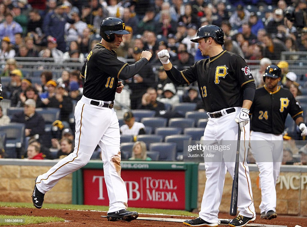 Neil Walker #18 of the Pittsburgh Pirates celebrates after scoring on an RBI single in the first inning by Starling Marte (not pictured) against the Cincinnati Reds during the game on April 12, 2013 at PNC Park in Pittsburgh, Pennsylvania.