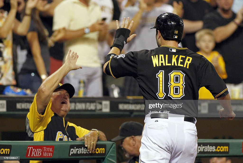 Neil Walker #18 of the Pittsburgh Pirates celebrates after scoring on an RBI single with manager <a gi-track='captionPersonalityLinkClicked' href=/galleries/search?phrase=Clint+Hurdle&family=editorial&specificpeople=223975 ng-click='$event.stopPropagation()'>Clint Hurdle</a> #13 in the eighth inning against the St. Louis Cardinals during the game on July 31, 2013 at PNC Park in Pittsburgh, Pennsylvania.