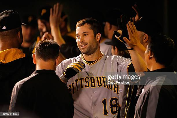 Neil Walker of the Pittsburgh Pirates celebrates his three run home run off of starting pitcher Christian Bergman of the Colorado Rockies to take a...