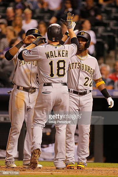 Neil Walker of the Pittsburgh Pirates celebrates his three run home run off of starting pitcher Christian Bergman of the Colorado Rockies with...
