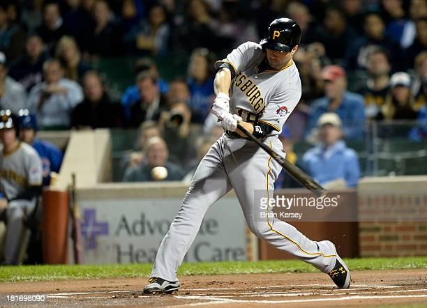 Neil Walker of the Pittsburgh Pirates connects on a solo home run during the first inning against the Chicago Cubs at Wrigley Field on September 23...
