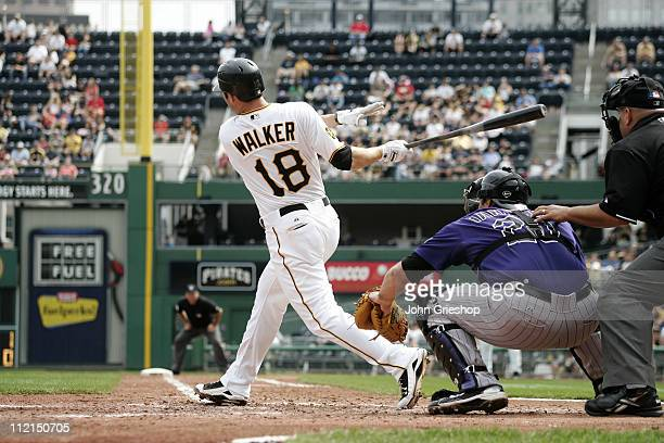Neil Walker of the Pittsburgh Pirates connects with a pitch during the game between the Colorado Rockies and the Pittsburgh Pirates on Sunday April...
