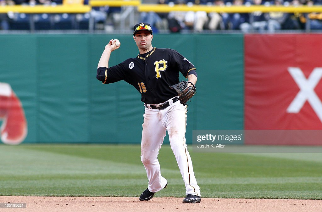 Neil Walker #18 of the Pittsburgh Pirates fields a ground ball against the Chicago Cubs during the opening day game on April 1, 2013 at PNC Park in Pittsburgh, Pennsylvania. The Cubs defeated the Pirates 3-1.