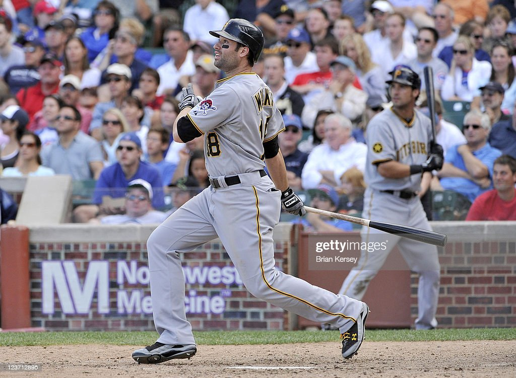 Neil Walker #18 of the Pittsburgh Pirates follows through on a two-run home run scoring Derrek Lee during the eighth inning against the Chicago Cubs at Wrigley Field on September 4, 2011 in Chicago, Illinois.