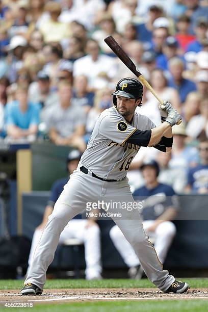 Neil Walker of the Pittsburgh Pirates gets ready for the next pitch during the game against the Milwaukee Brewers at Miller Park on August 24 2014 in...