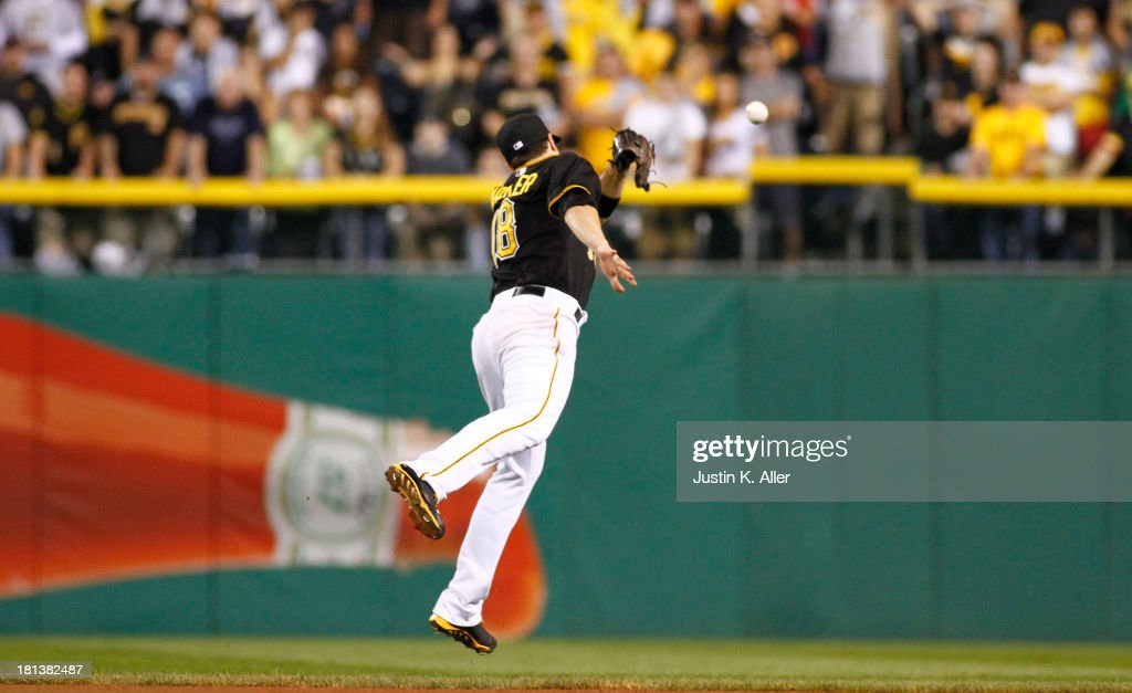 Neil Walker #18 of the Pittsburgh Pirates has a ball drop in over his head in the ninth inning against the Cincinnati Reds during the game on September 20, 2013 at PNC Park in Pittsburgh, Pennsylvania.