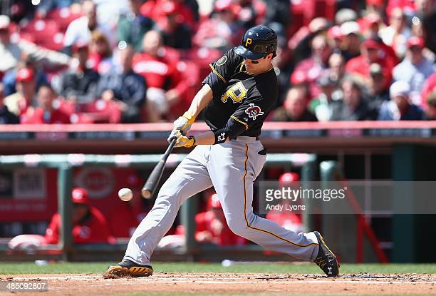 Neil Walker of the Pittsburgh Pirates hits a pitch during the game against the Cincinnati Reds at Great American Ball Park on April 16 2014 in...