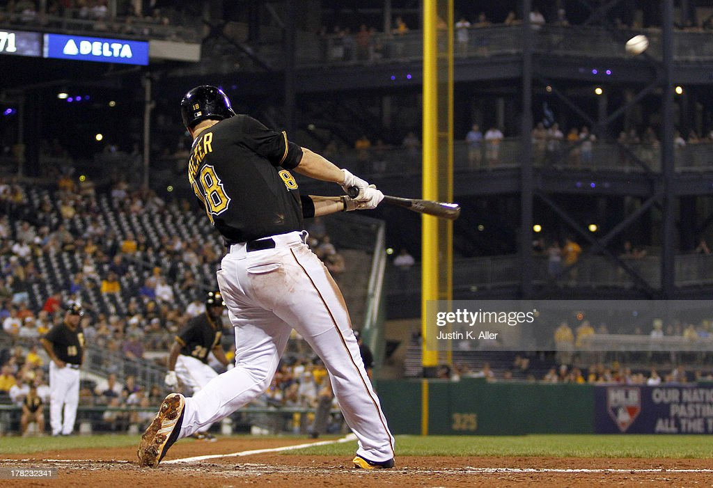 Neil Walker #18 of the Pittsburgh Pirates hits a three run home run in the fifth inning against the Milwaukee Brewers during the game on August 27, 2013 at PNC Park in Pittsburgh, Pennsylvania.