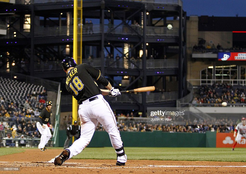 Neil Walker #18 of the Pittsburgh Pirates hits a two-RBI single in the second inning against the Cincinnati Reds during the game on April 12, 2013 at PNC Park in Pittsburgh, Pennsylvania.
