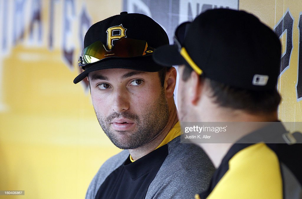 Neil Walker #18 of the Pittsburgh Pirates looks on from the dugout against the Los Angeles Dodgers during the game on August 16, 2012 at PNC Park in Pittsburgh, Pennsylvania. The Pirates defeated the Dodgers 10-6.