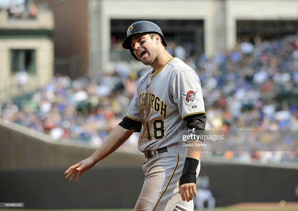 Neil Walker #18 of the Pittsburgh Pirates reacts after being called out at third base in the fourth inning against the Chicago Cubs on September 16, 2012 at Wrigley Field in Chicago, Illinois.