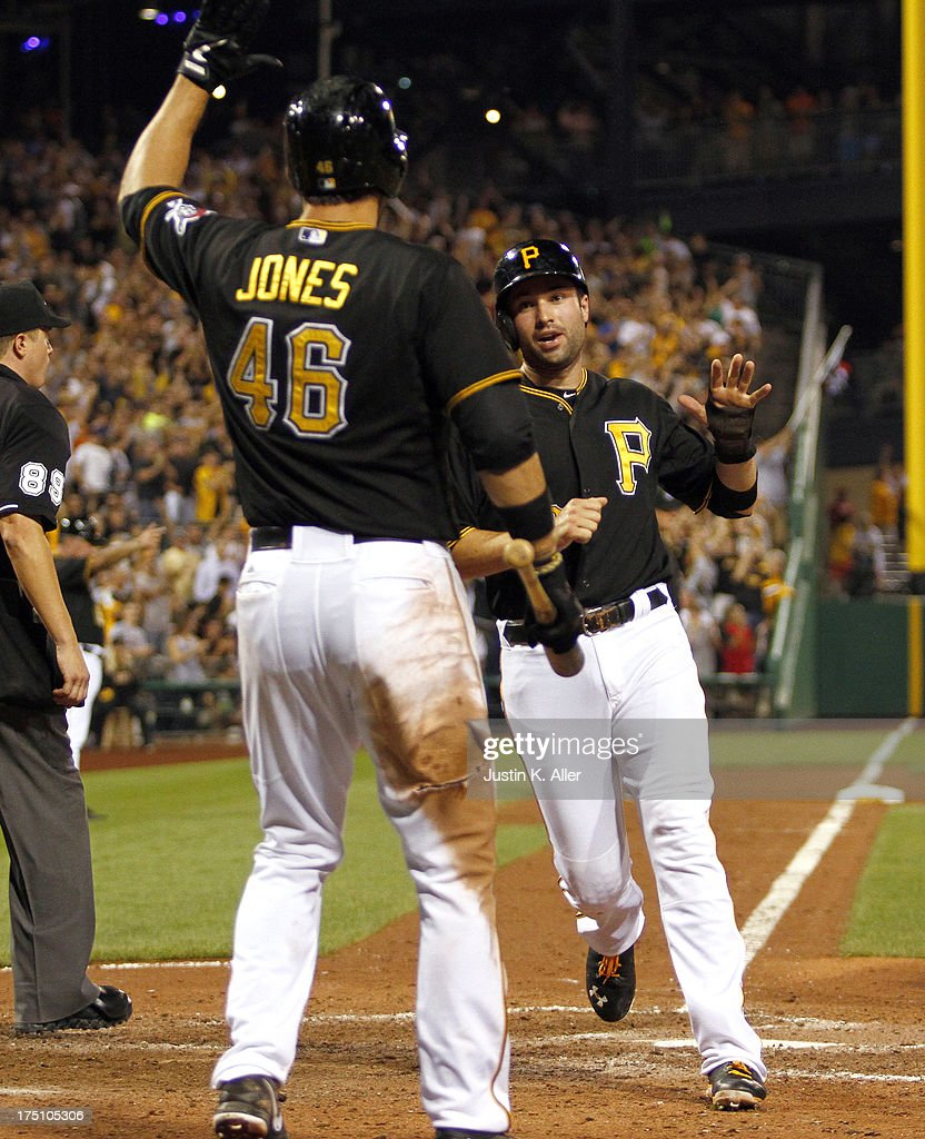 Neil Walker #18 of the Pittsburgh Pirates scores on an RBI single in the eighth inning against the St. Louis Cardinals during the game on July 31, 2013 at PNC Park in Pittsburgh, Pennsylvania.