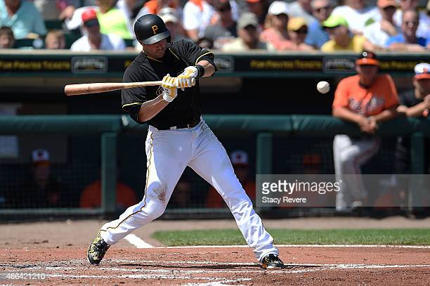 Neil Walker of the Pittsburgh Pirates swings at a pitch during the second inning of a spring training game against the Baltimore Orioles at McKechnie...