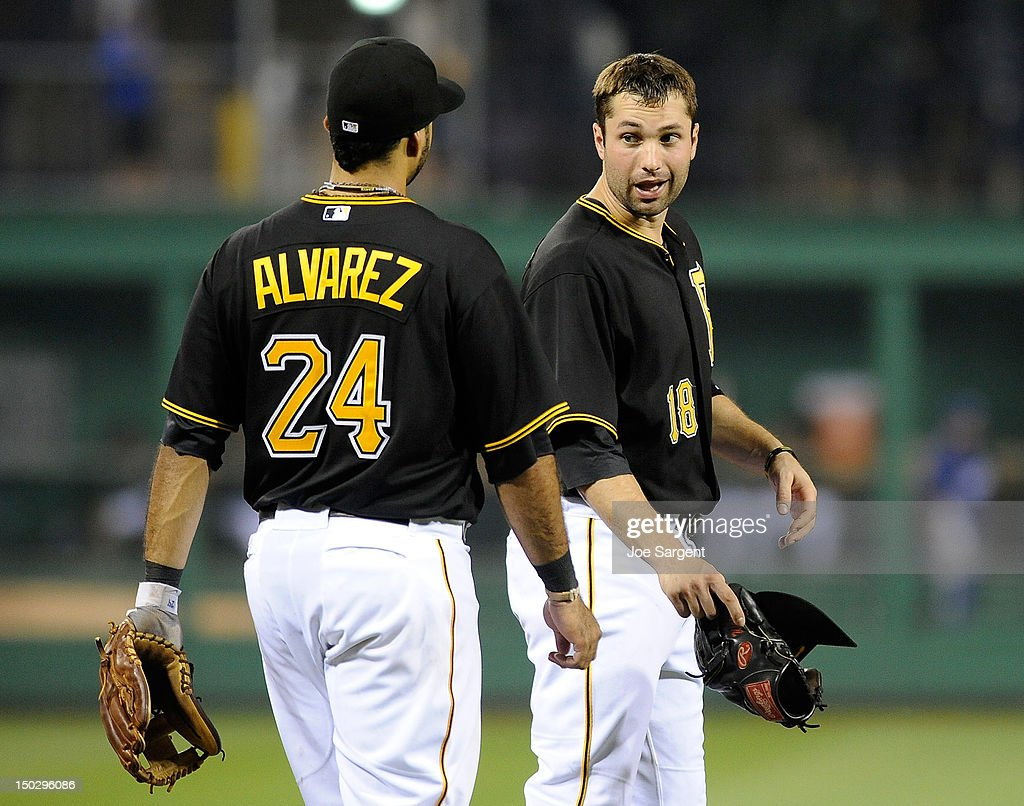 Neil Walker #18 of the Pittsburgh Pirates talks with Pedro Alvarez #24 between innings during the game against the Los Angeles Dodgers on August 14, 2012 at PNC Park in Pittsburgh, Pennsylvania. Los Angeles won the game 11-0.
