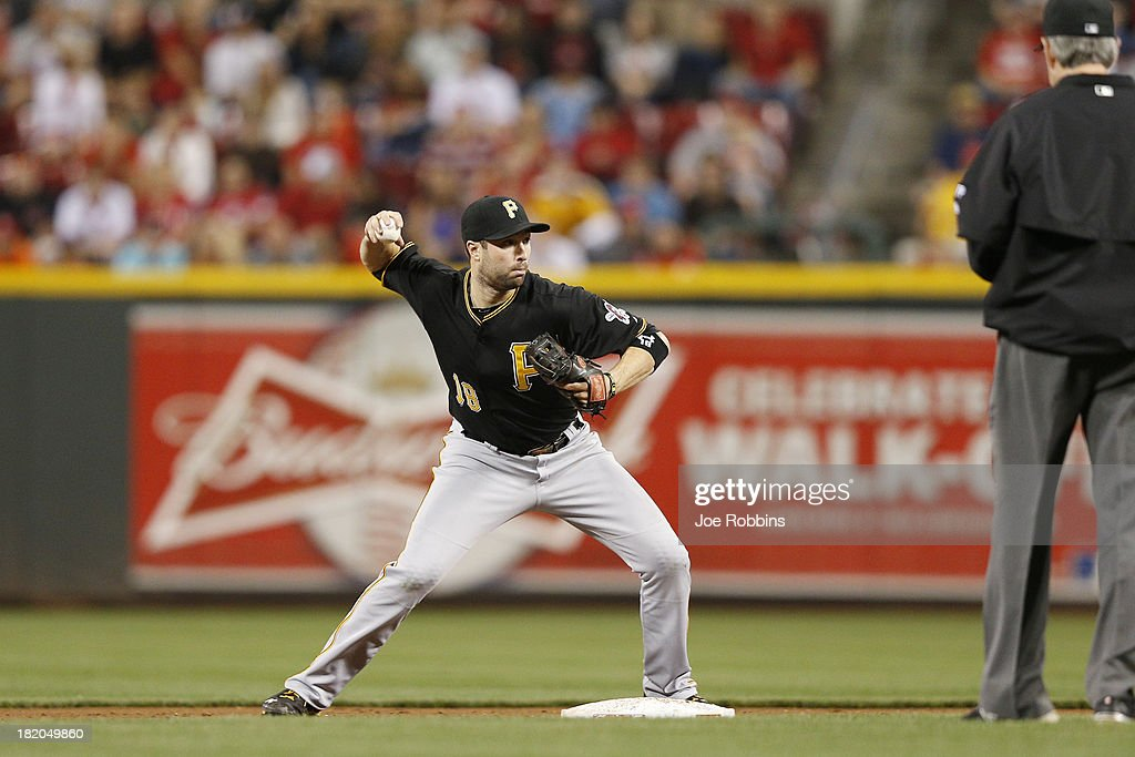 Neil Walker #18 of the Pittsburgh Pirates turns a double play in the ninth inning against the Cincinnati Reds during the game at Great American Ball Park on September 27, 2013 in Cincinnati, Ohio. The Pirates won 4-1.