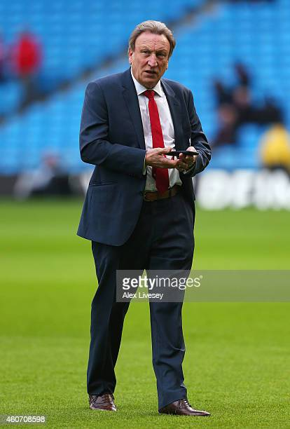 Neil Warnock manager of Crystal Palace looks on prior to the Barclays Premier League match between Manchester City and Crystal Palace at Etihad...