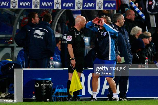 Neil Warnock manager of QPR gestures to one of the assistant referees during the npower Championship match between Queens Park Rangers and Watford at...