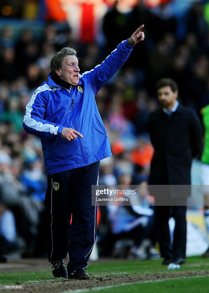 Neil Warnock the Leeds manager directs his players as Andre Villas-Boas the Spurs manager looks on during the FA Cup with Budweiser Fourth Round match between Leeds United and Tottenham Hotspur at Elland Road on January 27, 2013 in Leeds, England.
