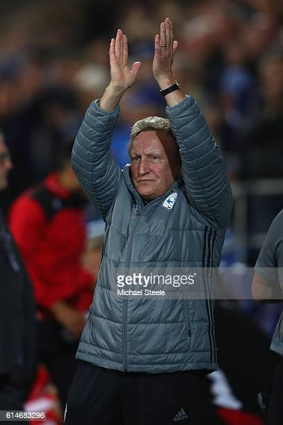Neil Warnock the manager of Cardiff applauds the home supporters ahead of his first match in charge during the Sky Bet Championship match between...