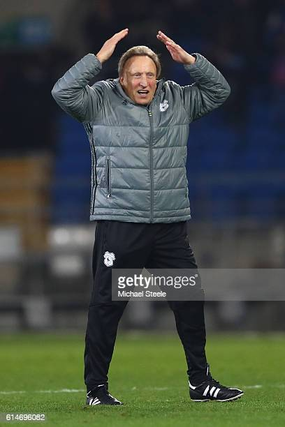 Neil Warnock the manager of Cardiff City celebrates his side's 21 victory with the 'Ayatollah' during the Sky Bet Championship match between Cardiff...