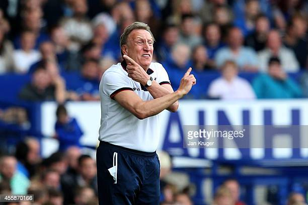 Neil Warnock the manager of Crystal Palace directs his players during the Barclays Premier League match between Everton and Crystal Palace at...