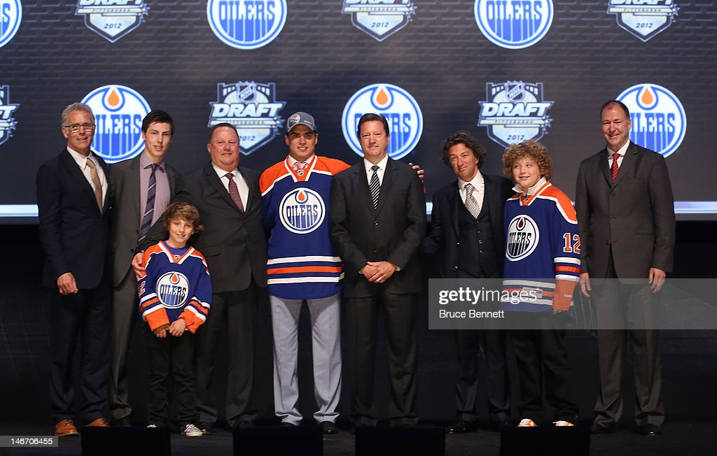 Neil Yakupov (C), first overall pick by the Edmonton Oilers, poses onstage with Oilers team representatives during Round One of the 2012 NHL Entry Draft at Consol Energy Center on June 22, 2012 in Pittsburgh, Pennsylvania.