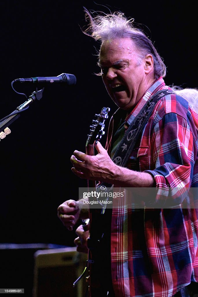 Neil Young and Crazy Horse perform during the 2012 Voodoo Experience at City Park on October 26, 2012 in New Orleans, Louisiana.