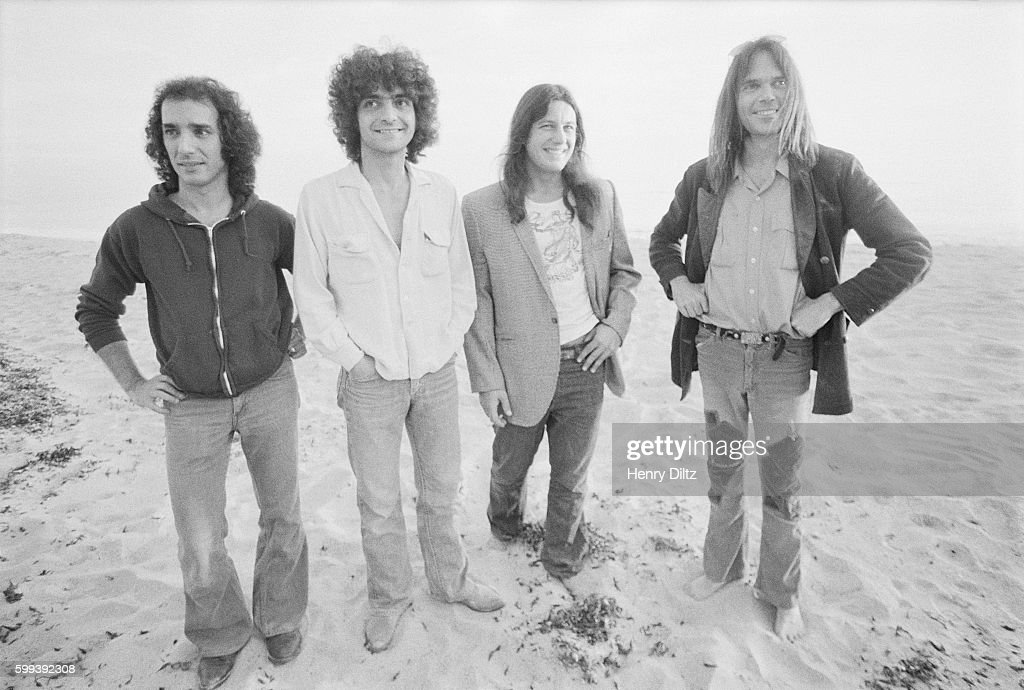 Neil Young (right) and his backup band Crazy Horse: Ralph Molina, Frank Sampedro, and Billy Talbot.