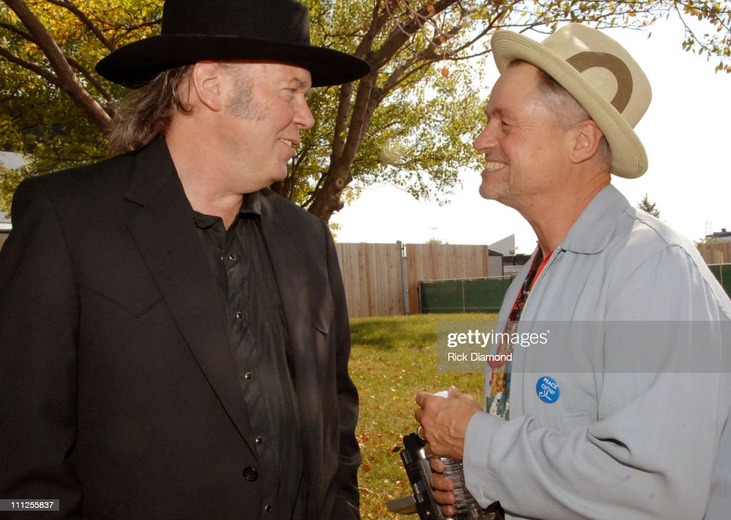 Neil Young and Jonathan Demme during FARM AID 2005 Presented by SILK Soymilk at Tweeter Center in Tinley Park, Illinois, United States.