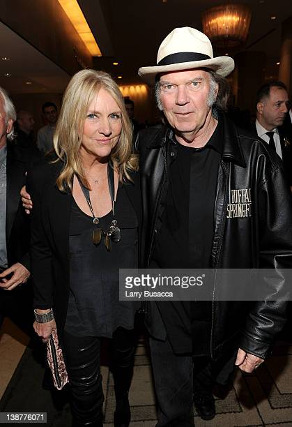 Neil Young and Pegi Young arrive at Clive Davis and the Recording Academy's 2012 PreGRAMMY Gala and Salute to Industry Icons Honoring Richard Branson...