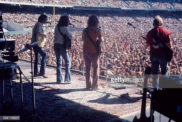 Neil Young Graham Nash David Crosby and Stephen Stills of Crosby Stills Nash And Young perform on stage at Oakland Colisseum on 13th July 1974 in...