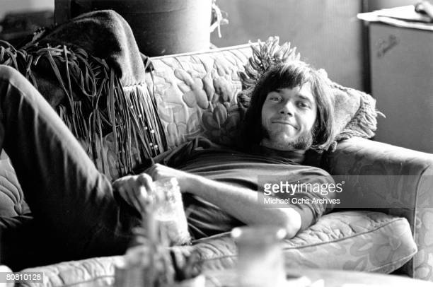Singer/Songwriter Neil Young of the rock and roll band 'Buffalo Springfield' relaxes on a couch in circa 1967 in Los Angeles California