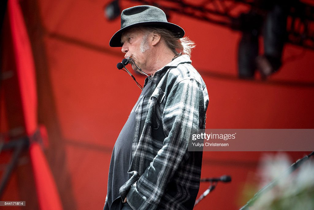 <a gi-track='captionPersonalityLinkClicked' href=/galleries/search?phrase=Neil+Young&family=editorial&specificpeople=209195 ng-click='$event.stopPropagation()'>Neil Young</a> perform at Roskilde Festival on July 1, 2016 in Roskilde, Denmark.