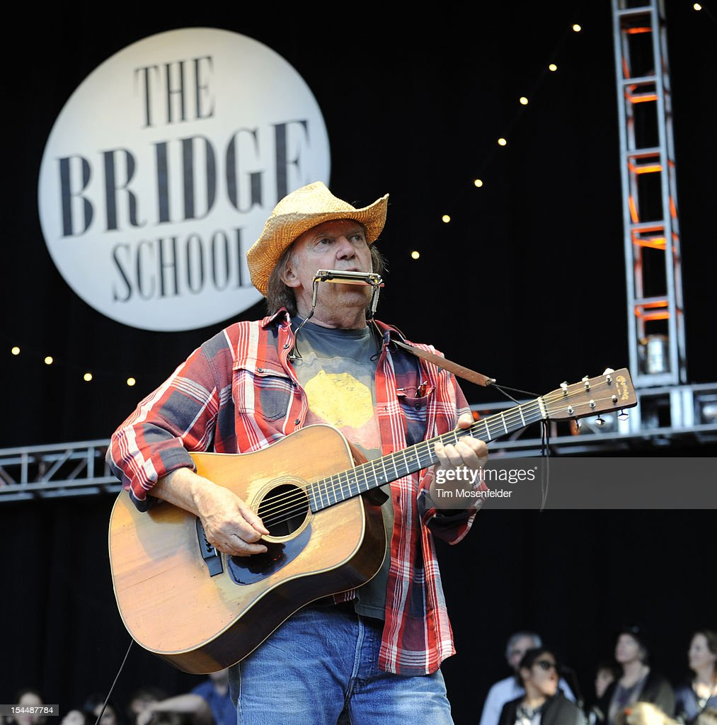 <a gi-track='captionPersonalityLinkClicked' href=/galleries/search?phrase=Neil+Young&family=editorial&specificpeople=209195 ng-click='$event.stopPropagation()'>Neil Young</a> performs as part of the 26th Annual Bridge School Benefit at Shoreline Amphitheatre on October 20, 2012 in Mountain View, California.