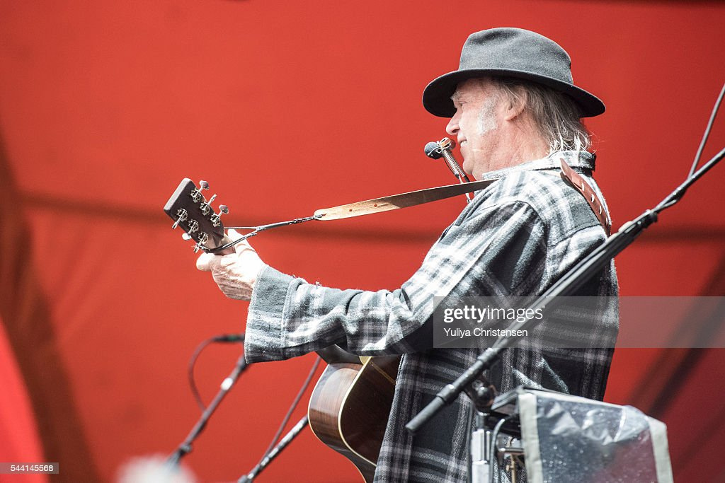 <a gi-track='captionPersonalityLinkClicked' href=/galleries/search?phrase=Neil+Young&family=editorial&specificpeople=209195 ng-click='$event.stopPropagation()'>Neil Young</a> performs at Roskilde Festival on July 1, 2016 in Roskilde, Denmark.