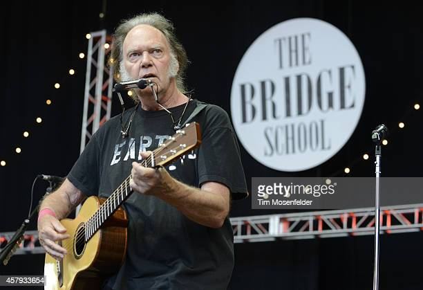 Neil Young performs during the 28th annual Bridge School Benefit at Shoreline Amphitheatre on October 26 2014 in Mountain View California