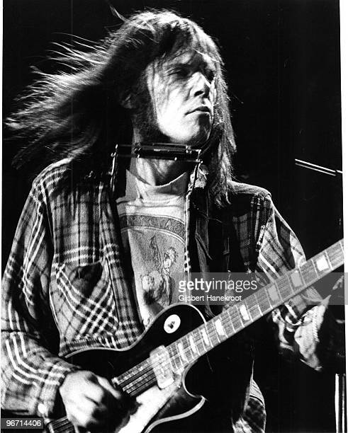 Neil Young performs live on stage with members of Crazy Horse in Copenhagen Denmark on March 16 1976