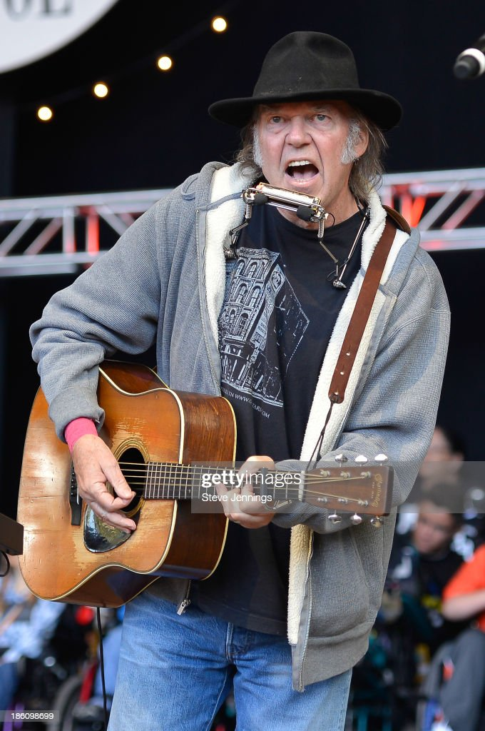 Neil Young performs on Day 2 of the 27th Annual Bridge School Benefit concert at Shoreline Amphitheatre on October 27, 2013 in Mountain View, California.