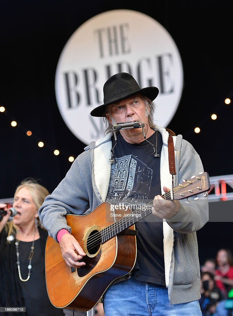 <a gi-track='captionPersonalityLinkClicked' href=/galleries/search?phrase=Neil+Young&family=editorial&specificpeople=209195 ng-click='$event.stopPropagation()'>Neil Young</a> performs on Day 2 of the 27th Annual Bridge School Benefit concert at Shoreline Amphitheatre on October 27, 2013 in Mountain View, California.