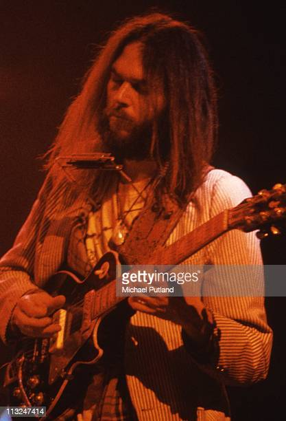 Neil Young performs on stage at the Rainbow Theatre London 5th November 1973 He plays a Gibson Les Paul guitar