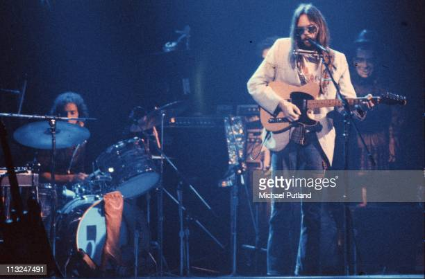 Neil Young performs on stage at the Rainbow Theatre with The Santa Monica Flyers Ralph Molina on drums London 5th November 1973